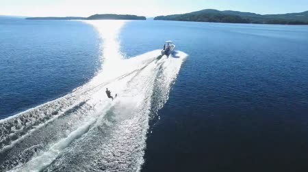 földközi tenger : Amazing seascape aerial shot of a jet water skier in calm sea and big white wave