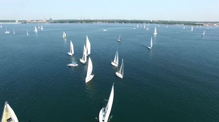 veleiro : Aerial 4k seascape drone shot of sailing boats yachts in open sea on sunny day