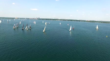 veleiro : Seascape aerial 4k shot of sailing yachts in open calm water on sunny summer day