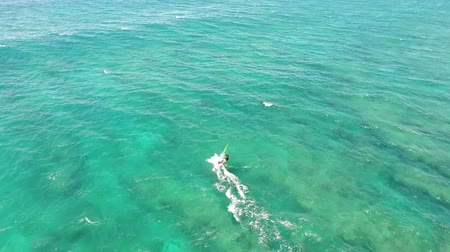 tyrkysový : Professional windsurfer gliding in calm turquoise blue ocean wave water seascape, extreme summer sport in 4k aerial view