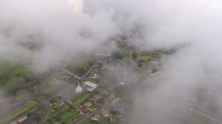 bezmotorové létání : 4k aerial drone camera view flying through fluffy rain white clouds high in clear blue sky over green counrtyside town