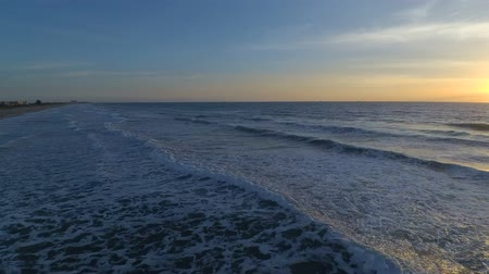 kakao : Amazing 4k aerial drone cam view on warm sunrise over calm white foam ocean waves in Florida Cocoa surf beach seascape