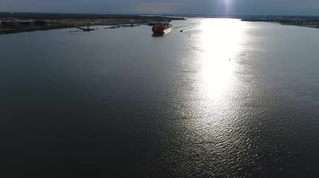 sending : Amazing 4k aerial seascape panorama view on huge red loaded cargo freight container ship sailing slowly in calm ocean
