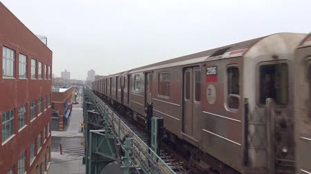 horas : 4k shot of modern urban silver steel subway car train moving fast on rail road in Brooklyn downtown tube metro station Stock Footage