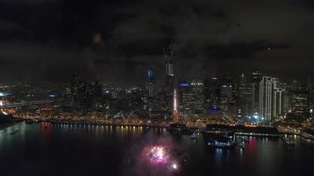 beautifully : 4k aerial view on amazing colorful light bright firework bursting exploding beautifully in night sky over San Francisco Stock Footage