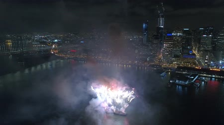 beautifully : Shining colorful light bright firework bursting exploding beautifully in dark night sky over San Francisco in 4k aerial