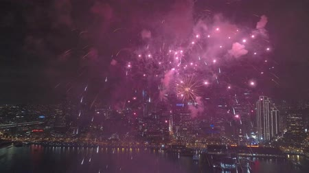 beautifully : 4k aerial view on shining colorful light bright firework bursting exploding beautifully in night sky over San Francisco