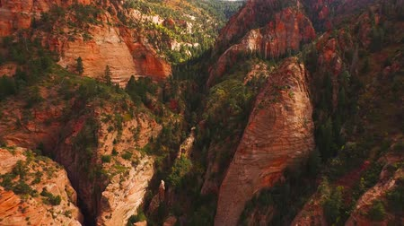 fennsík : Amazing 4k aerial drone shot huge glorious american red orange sand stone cliff mountain range canyon sunset landscape