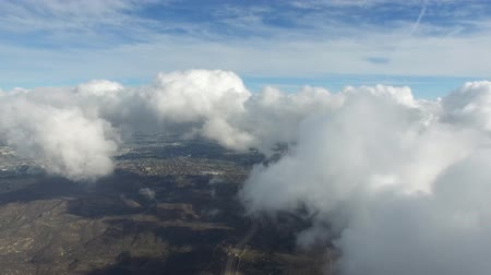 buço : Flying in fluffy white rain clouds in clear blue sky over mountain landscape in incredible aerial drone 4k camera shot Vídeos
