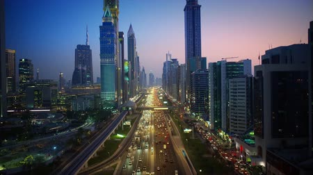 arabian sea : Incredible city Dubai downtown modern building architecture in pink evening sunset night illumination 4k aerial flyover