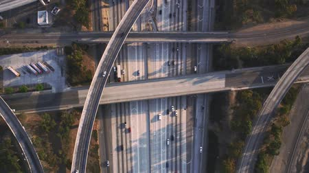 genişleme : Fascinating top aerial drone panorama flight over busy highway multiple vehicle road with traffic cement junction bridge
