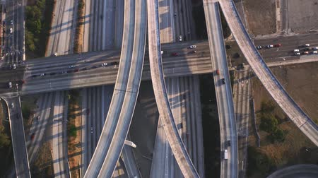 genişleme : Multiple vehicle busy highway road with traffic cement junction bridges in stunning top aerial drone panorama flyover Stok Video
