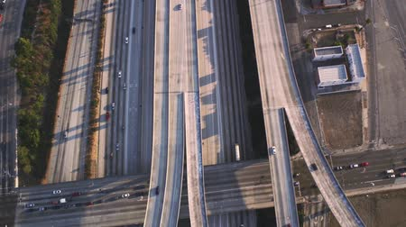 csomópont : Busy highway road multiple vehicle with traffic cement junction bridge in amazing top aerial drone panorama flyover Stock mozgókép
