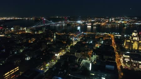 Impressive aerial 4k drone panorama flyover modern Philadelphia city downtown in dark night light illumination cityscape Stok Video
