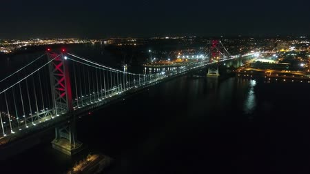 Bridge across river in big modern Philadelphia city downtown in night light illumination in gorgeous 4k aerial cityscape