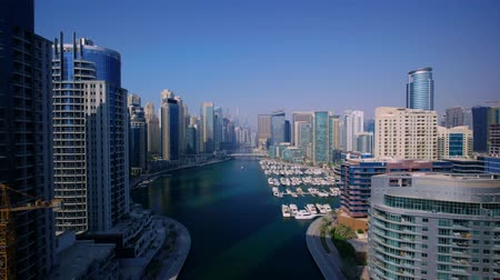 Magnificent 4k aerial drone panorama flight in clear blue sky over modern urban architecture of Dubai big city cityscape