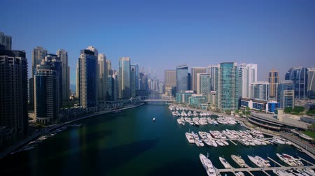 Picturesque 4k aerial drone panorama flight in clear blue sky over modern urban architecture of Dubai big city cityscape Stok Video