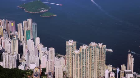 camera flies over skyscrapers in the background of the sea, Hong Kong Stok Video
