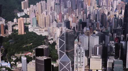 határkő : aerial drone footage of rooftops and streets in the densely populated Kowloon area in Hong Kong