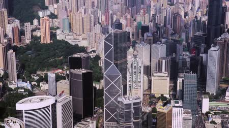határkő : Abstract aerial drone footage of rooftops and streets in the densely populated Kowloon area in Hong Kong