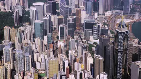 Top view aerial from flying drone of a developed Hong Kong city with modern skyscrapers with contemporary design.