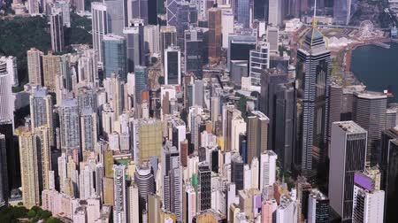 işletmeler : Top view aerial from flying drone of a developed Hong Kong city with modern skyscrapers with contemporary design. China town with business and financial centers