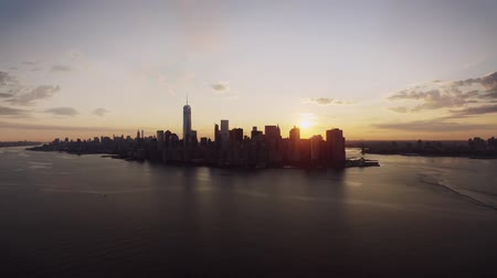 Warm orange evening sunset sky over New York urban famous skyline cityscape in magnificent drone aerial panorama flight