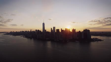Warm orange evening sunset sky over New York famous popular skyline cityscape in incredible drone aerial panorama flight