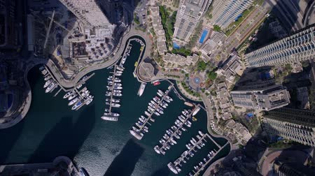 United Arab Emirates Aerial drone view of Dubai marina harbor with boat yacht and skyscraper buildings in downtown. Stok Video
