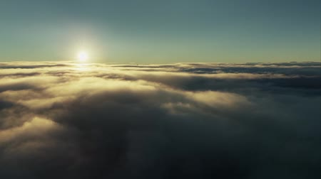 Flying over the evening timelapse clouds with the late sun. Seamlessly looped animation.