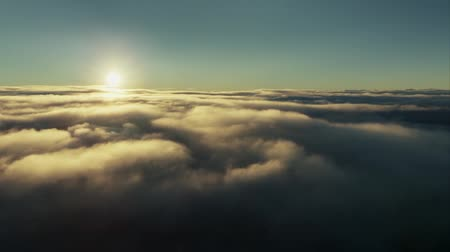 Flight through moving cloudscape with beautiful sun rays. Perfect for cinema, background, digital composition Stok Video