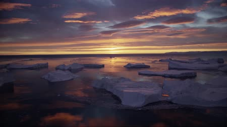 disko bay : Arctic nature landscape with icebergs in Greenland icefjord with midnight sun sunset. Ilulissat Icefjord with icebergs from glacier.