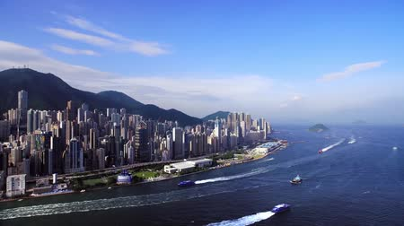View from the height of the skyscrapers of Hong Kong, filming with a drone above the sea