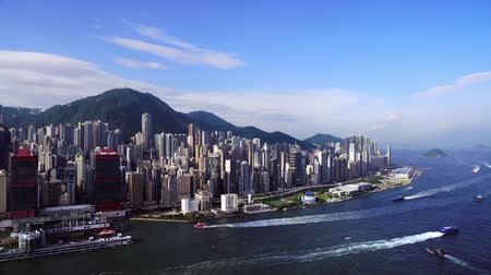 shooting from a drone, view from the sea on skyscrapers hong kong, boats and ships are floating below Stok Video