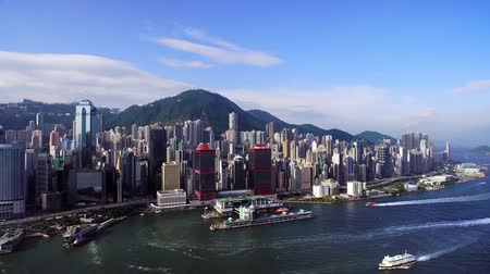 shooting from a drone, the view from the sea at the skyscrapers of Hong Kong, the ship sails Stok Video