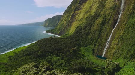 Cinematic aerial view of beautiful waterfall on North Shore of Kauai, Hawaii