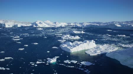 disko bay : Drifting by an iceberg floating in Qooroq Icefjord, South Greenland