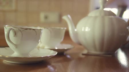 seramik : Cups and teapot on the table for tea Stok Video