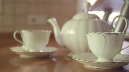 rolety : Cups and teapot on the table for tea Wideo