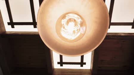 závit : incandescent lamp in the chandelier close-up slow-motion video