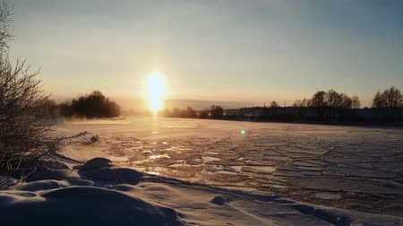 szron : winter frosty sunset over the frozen snow-covered river