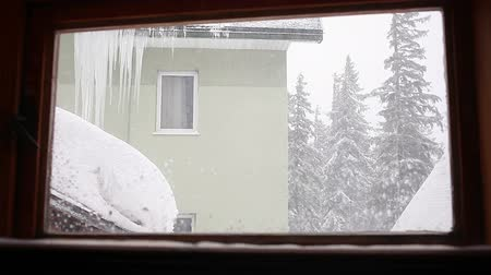 outside view : Snowstorm View from indoor through the Window Stock Footage