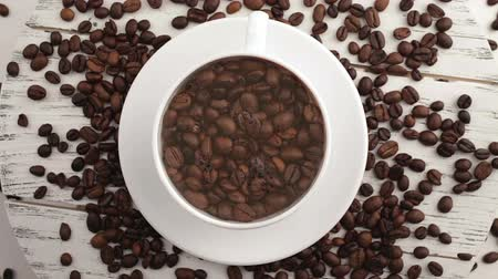 black coffee : Morning coffee. Coffee magic. Roasted coffee beans turn into fragrant drink. Stock Footage
