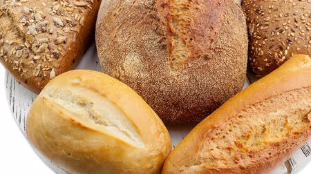 ciabata bread : Breads and baked goods: Camera pans across large assortment in HD video Stock Footage