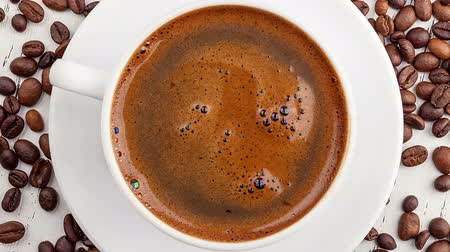 black coffee : Morning coffee. Coffee magic. Roasted coffee beans Stock Footage