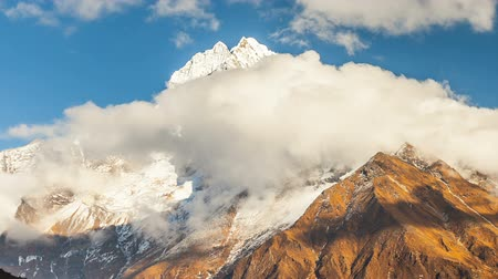 sherpa : Mount Kangtega and moving clouds. Track to the base camp of Everest in the Himalayas. Sagarmatha National Park, Nepal