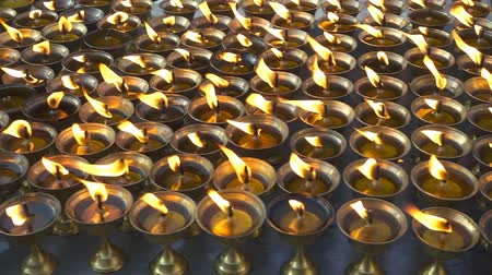 bodhnath : Burning ritual candles in nepali temple. Kathmandu, Nepal. Stock Footage