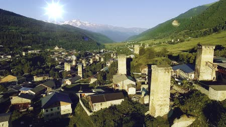 remote location : Overview of Mestia, famous for its Svan towers, in the mountainous Northwest of Georgia in the Caucasus Stock Footage