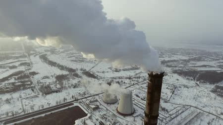 reactor : Flying over the large pipe plant for the production of thermal energy Aerial. Breathtaking Aerial Flyover Of Factory, Smoke Stack, Industrial Energy plant. Stock Footage