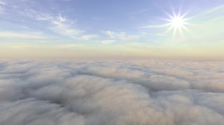 midair : aerial view above the clouds towards the sun